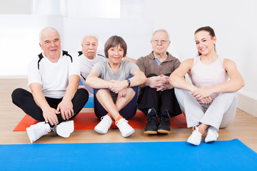 Female Trainer With Senior Customers At Gym