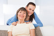 Portrait Of Happy Caregiver With Senior Woman