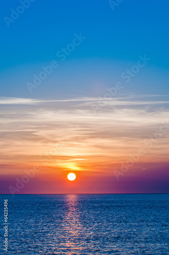 Foto op Plexiglas Kust sunset at sea with multiple color prizm