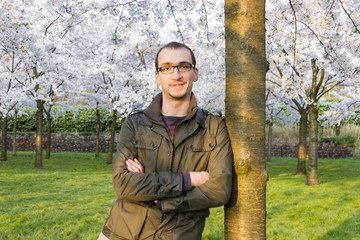 men enjoying blossom trees