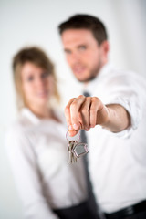 close-up picture of cheerful couple holding house keys