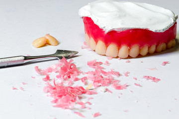 tool for make a wax dentures model. table of dental technician w