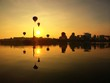reflection hot air ballon at sunrise