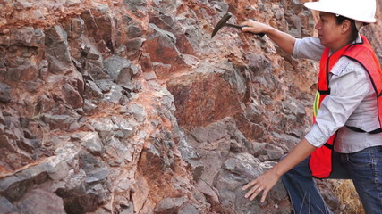 Female Mining Prospector Rock Chipping