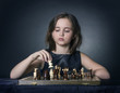 teen girl playing chess