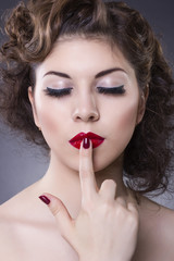 Fashion Model Girl portrait. Red Sexy Lips and Nails closeup.