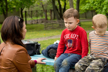 Woman having a serious talk with a small boy
