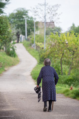 The slow journey of a lady just outside the village