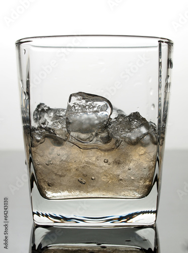 Ice and water in glass Poster