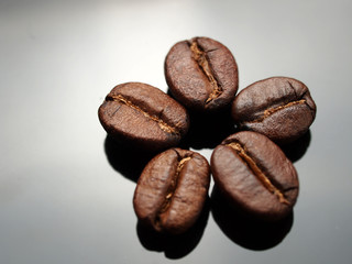 Coffee beans on metal gray plate background
