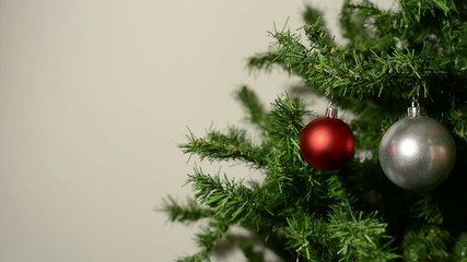 Decorating the Christmas tree with decorative balls