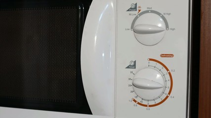 close and turn on the white oven