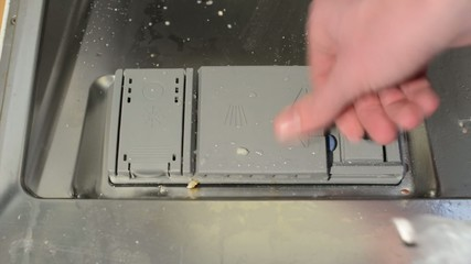insert detergent tablet to the dishwasher (opening for tablet)