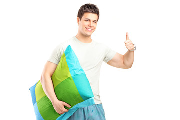 Man in pajamas giving thumb up