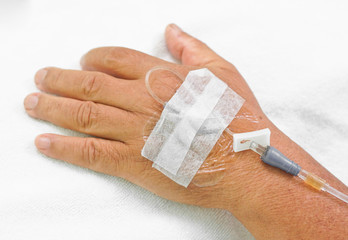 hands of patient with IV solution