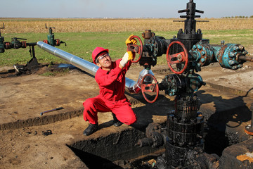 Oil and Gas Worker Turning Valve
