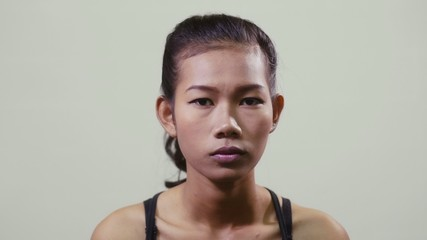 Portrait of asian woman looking at camera, young people