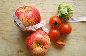 Vegetable diet. Apple with measuring tape (diet concept)