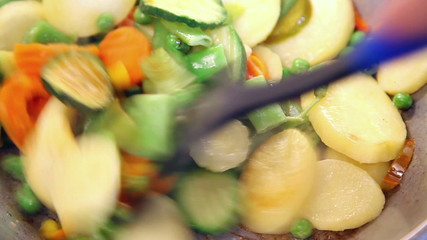 stirring vegetable mix with spatula