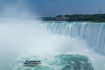 Tourist boat heading towards Niagara Falls, Ontario, Canada