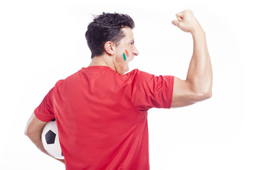 Soccer fan supporting his team, isolated on white
