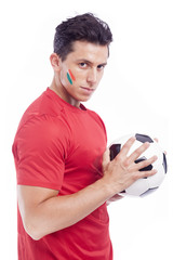 Portrair of a soccer fan holding a ball, isolated on white