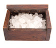 A group of rock sugar in a wooden box