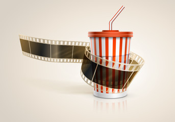 Camera film roll and cardboard cup with a straw.