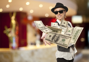 woman in cap throwing dollar