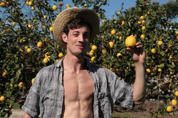 young farmer happy of his lemons