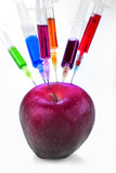 Genetic modification of fruit with a syringe full of chemicals poster