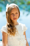 Attractive youngster in white communion dress. poster
