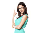 beautiful brunette with glasses shows a finger upwards