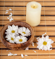 Spa decoration with candle and daisies