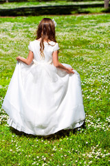 Girl walking in flower field.