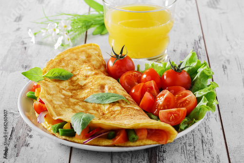 Foto op Canvas Egg omelet with vegetables and cherry tomatoes