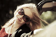 Happy young blond woman at the convertible car