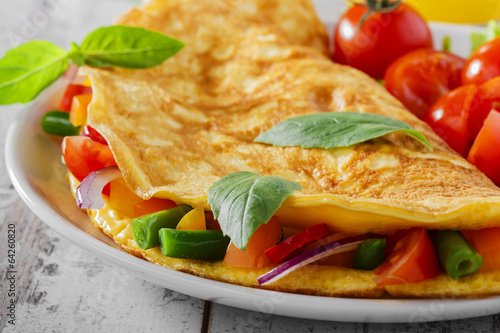 Keuken foto achterwand Egg omelet with vegetables and cherry tomatoes