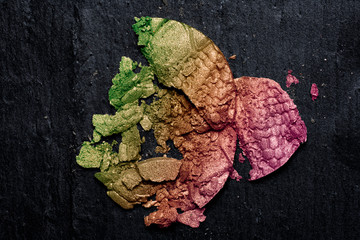 Colorful Crushed Eye Shadow on Blackboard