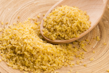 bulgur wheat in wooden spoon
