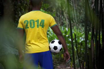 Brazilian Football Player Holding Soccer Ball in Jungle