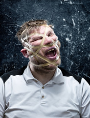 Freak man with rubber on his face