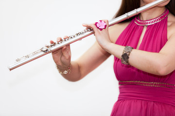 Cropped view of woman playing on silver flute