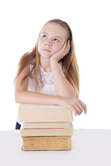 Thoughtful schoolgirl with pile of books