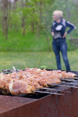 Meat kebabs cooking over a summer BBQ