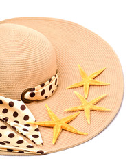 Woman beach hat and a seashell