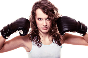 Sport boxer woman in gloves. Fitness girl training kick boxing.