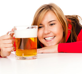 pretty girl in red drinking beer from the mug