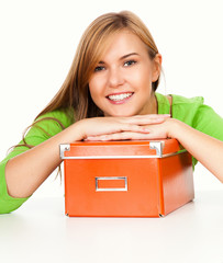 beautiful teen woman with orange box, smiling