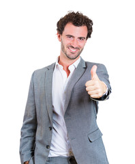 Thumbs up gesture. Handsome happy young businessman